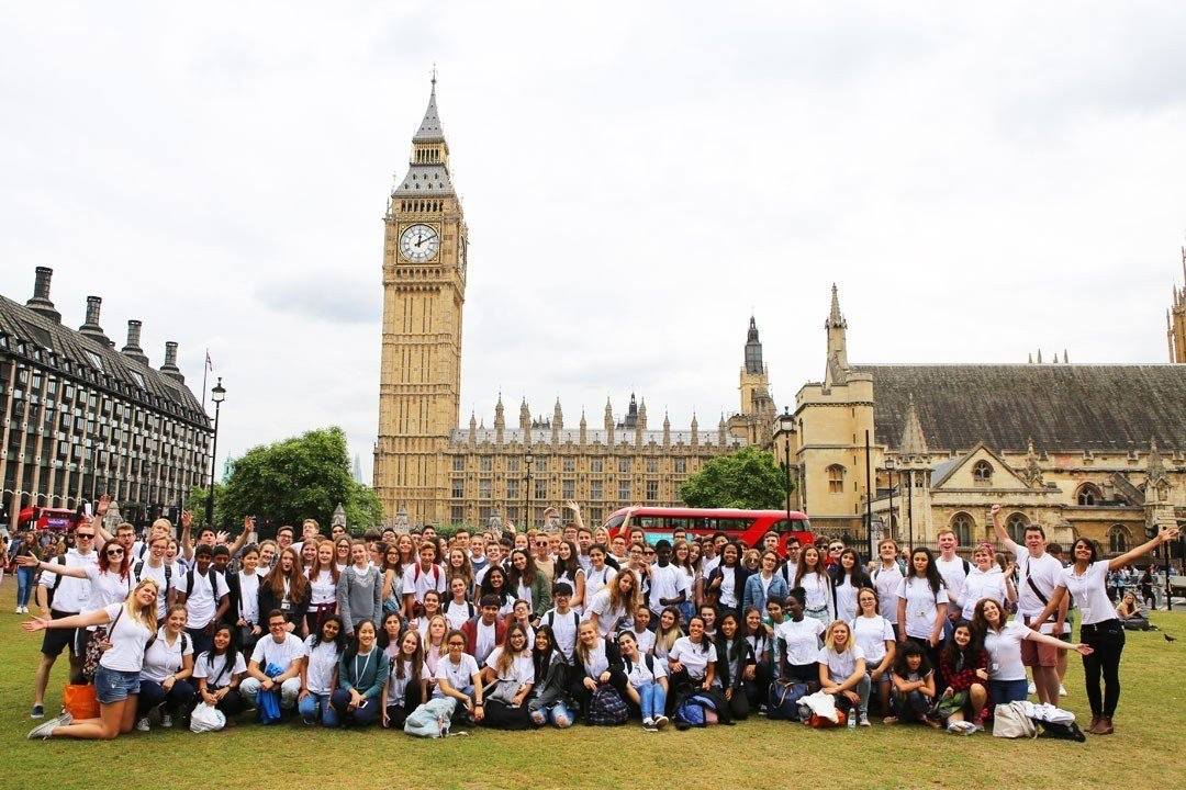 The Ingenium Academy - students sightseeing outside the Houses of Parliament in Parliament Square, London