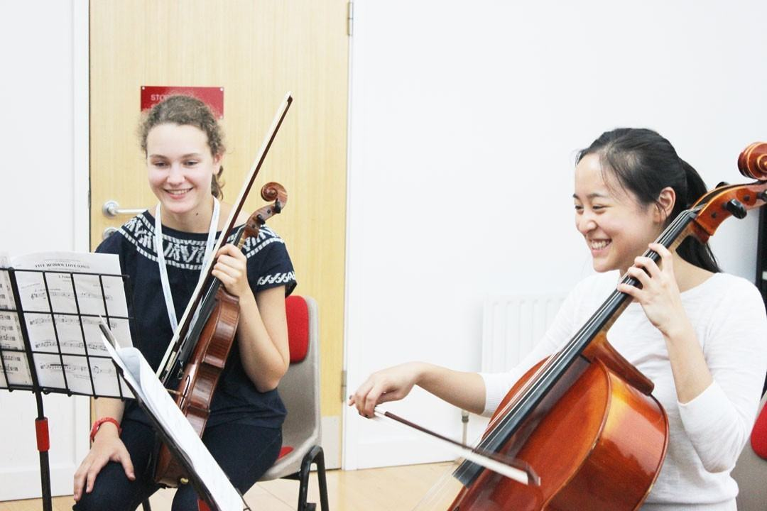 Cello and viola students in a chamber music workshop