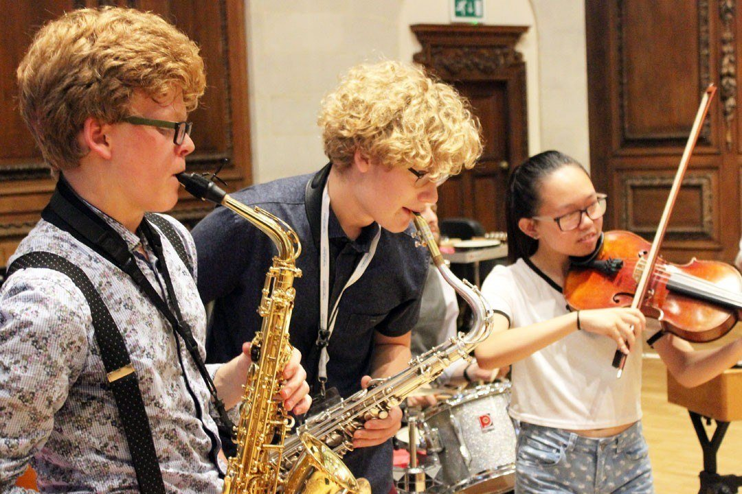 Young saxophone players collaborating with other students from our orchestral programme
