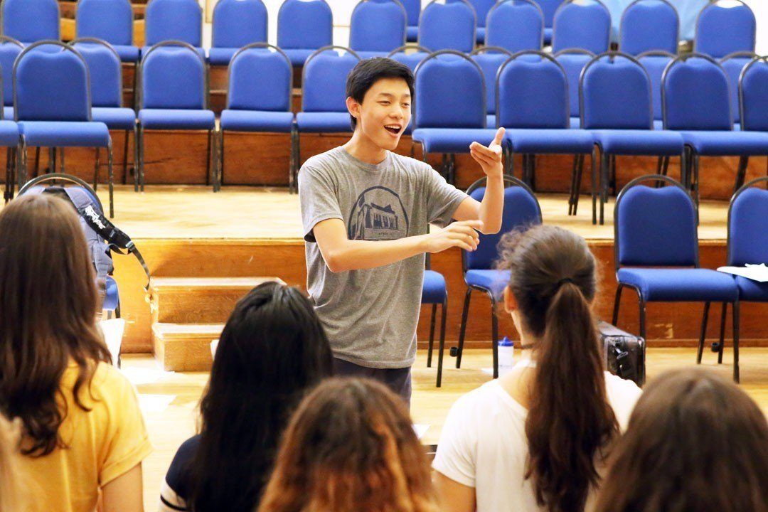 Conducting student Jonja leading the Ingenium Academy choir in rehearsal at Winchester College
