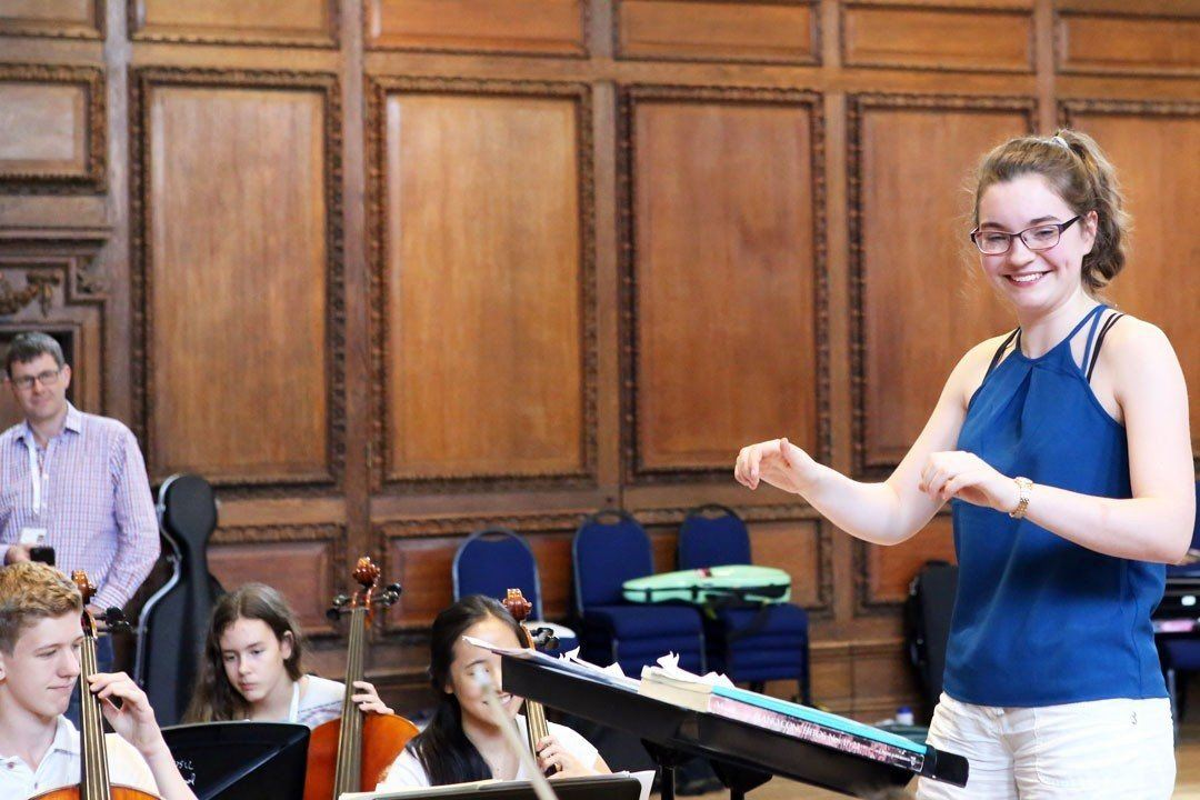 Student conductor leading the orchestra