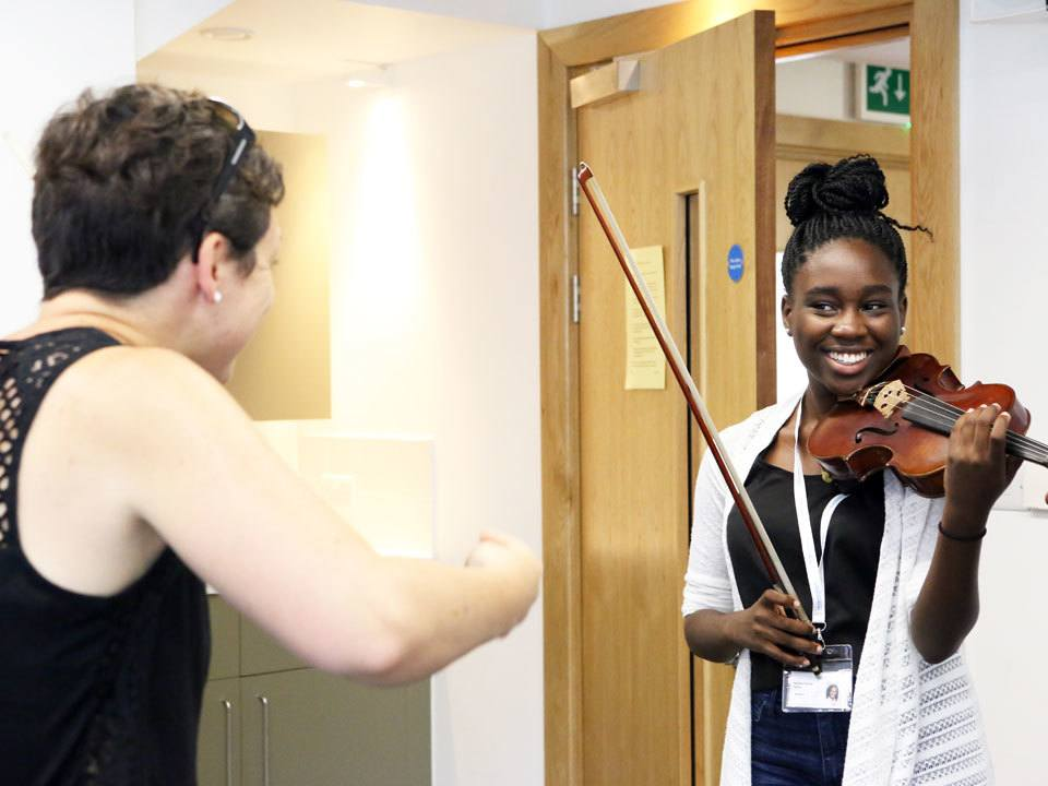 Clare Duckworth (London Symphony Orchestra) teaching a violin lesson at the Ingenium Academy, England