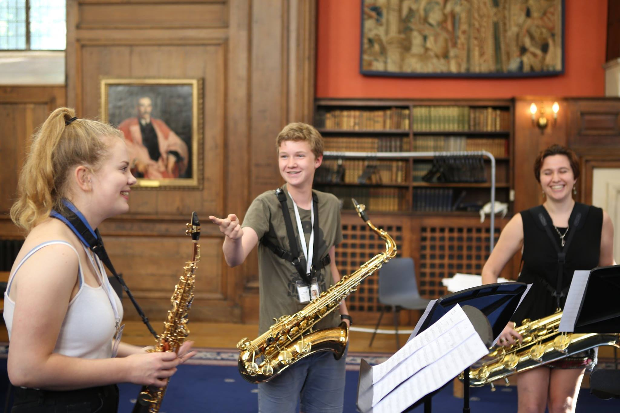 Saxophone quartet rehearsal with young musicians