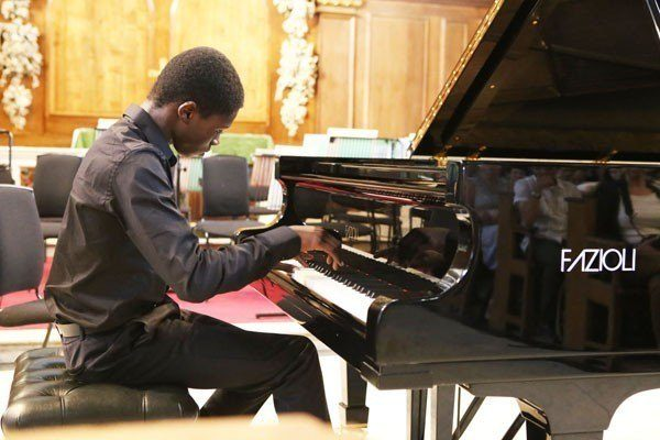 Piano student Christian giving a performance in London