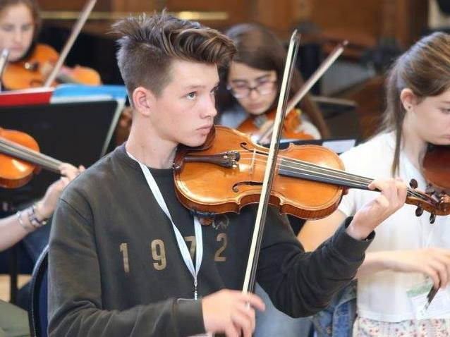 Oscar, violin student, summer music residential course, England