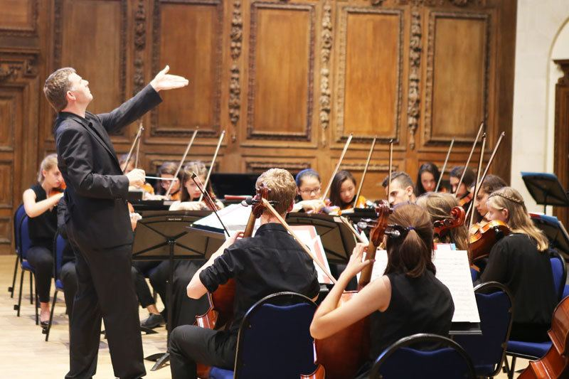 Conductor Timothy Redmond, conducting the Ingenium Academy symphony orchestra, summer 2017