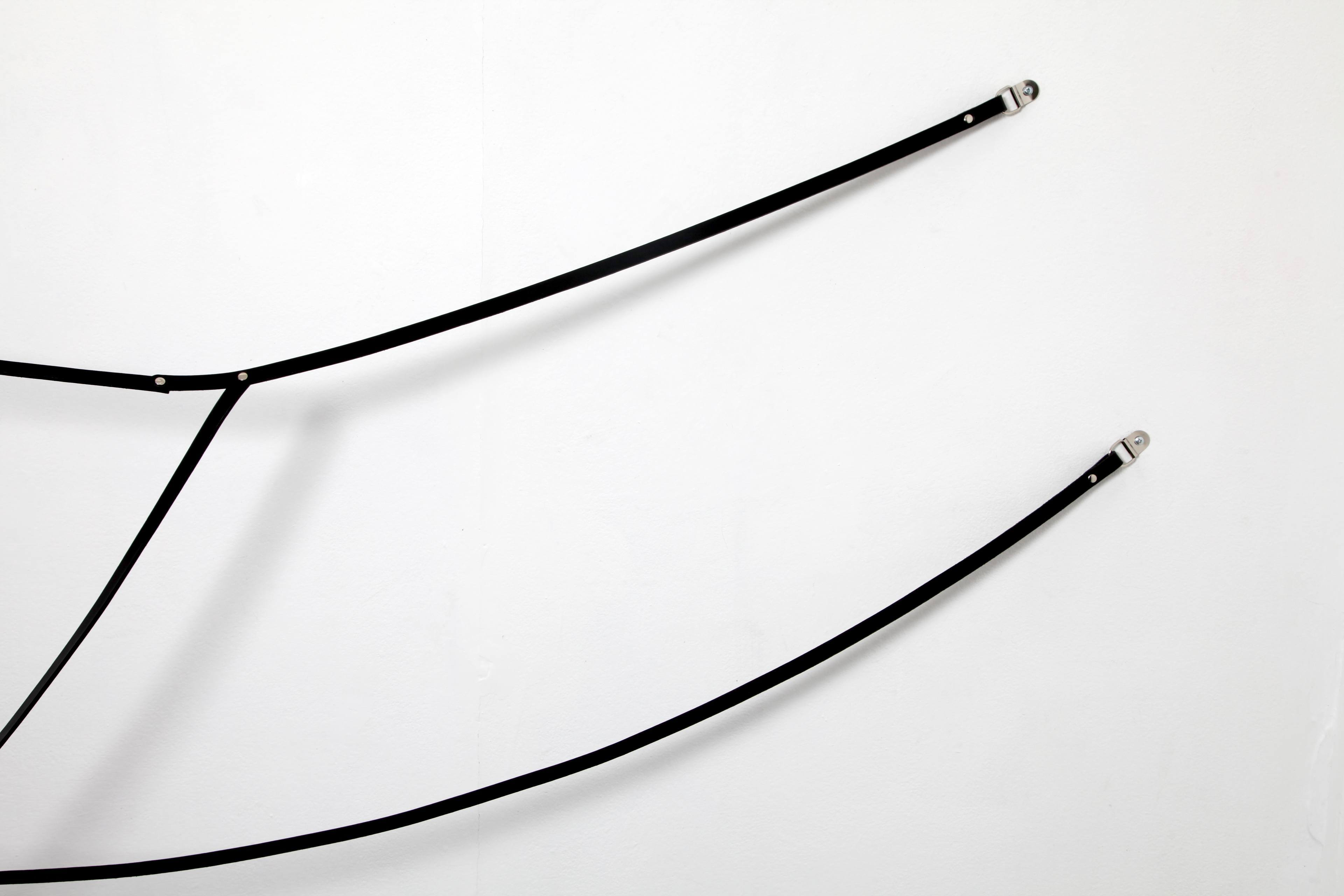 Simona Brinkmann. Blank Stare, Flat Hollow at Five Years, London (2013). Arm's Length. Leather, metal fittings.