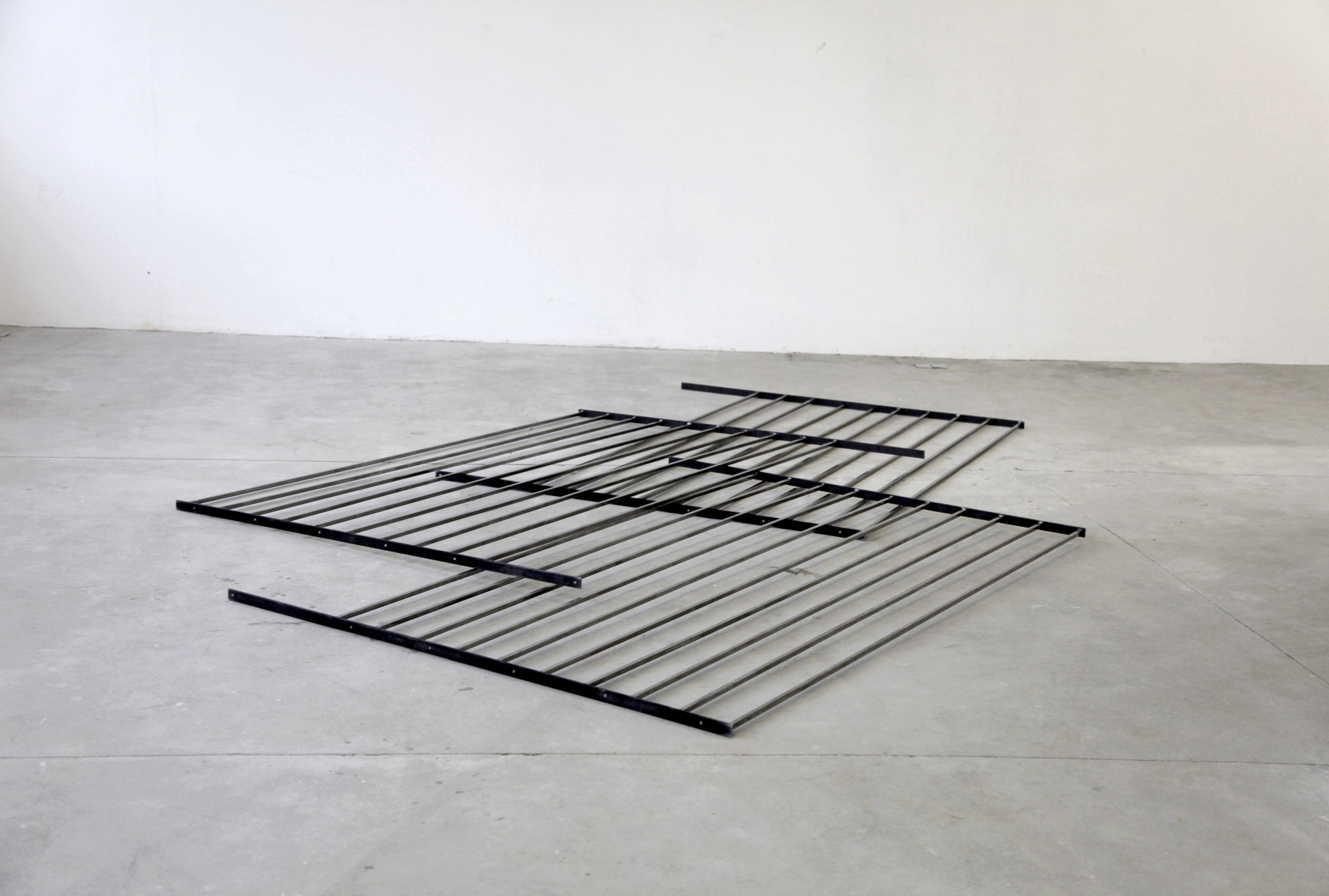 Simona Brinkmann, Bridges Become Doors, 2012-2016, steel and graphite paste, floor sculpture, collapsed gate doors