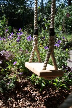 oak rope swing in garden