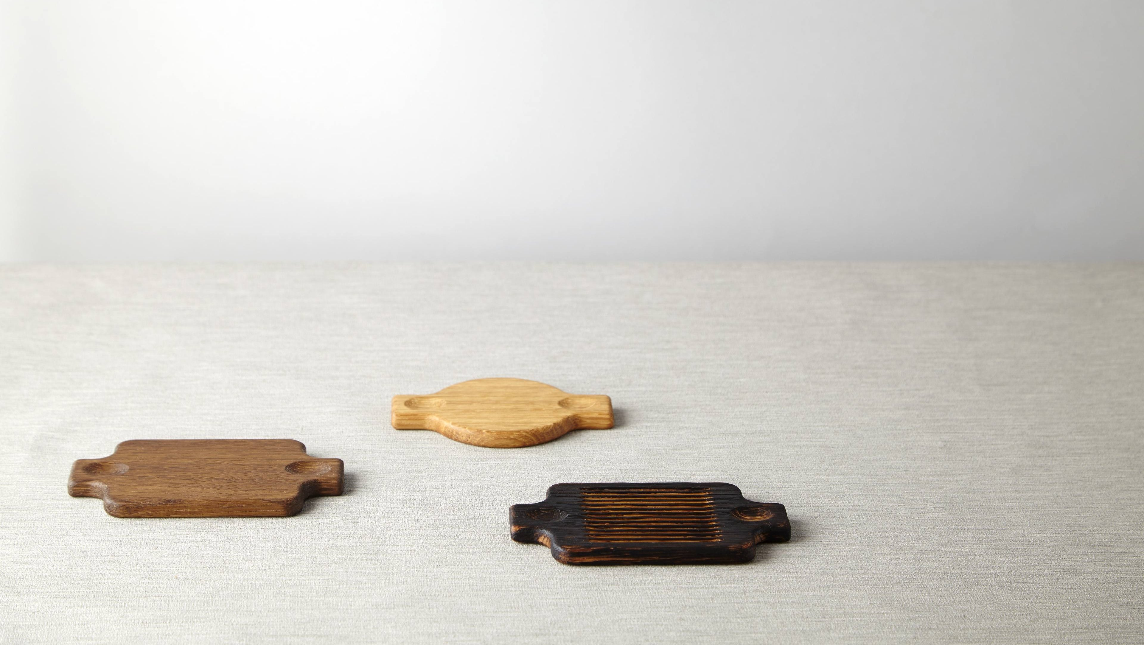 3 wooden boards made from natural, fumed and scorched oak