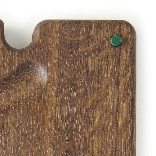 green feet on fumed oak board