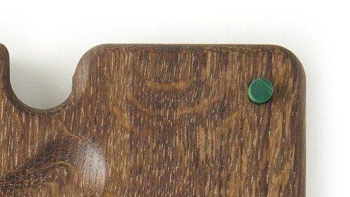 Green feet on bottom of oak board
