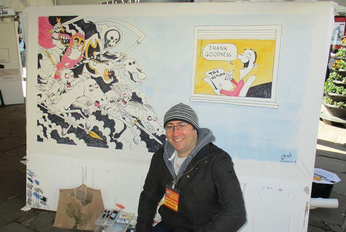Simon with his finished Shrewsbury Cartoon Festival cartoon