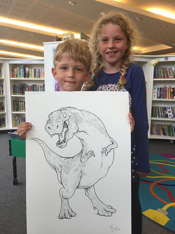 Oisin and Aoife got to take home one of Simon's drawings