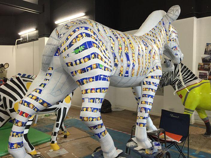 The Trojan Zebra up on stools