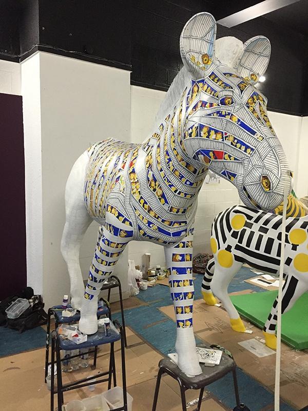 Trojan Zebra balanced on stools