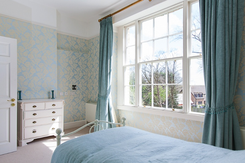 One of our individually decorated and furnished bedrooms overlooking the grounds.