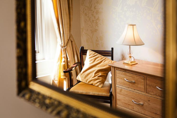 A reflected view of a Blackbrook House bedroom