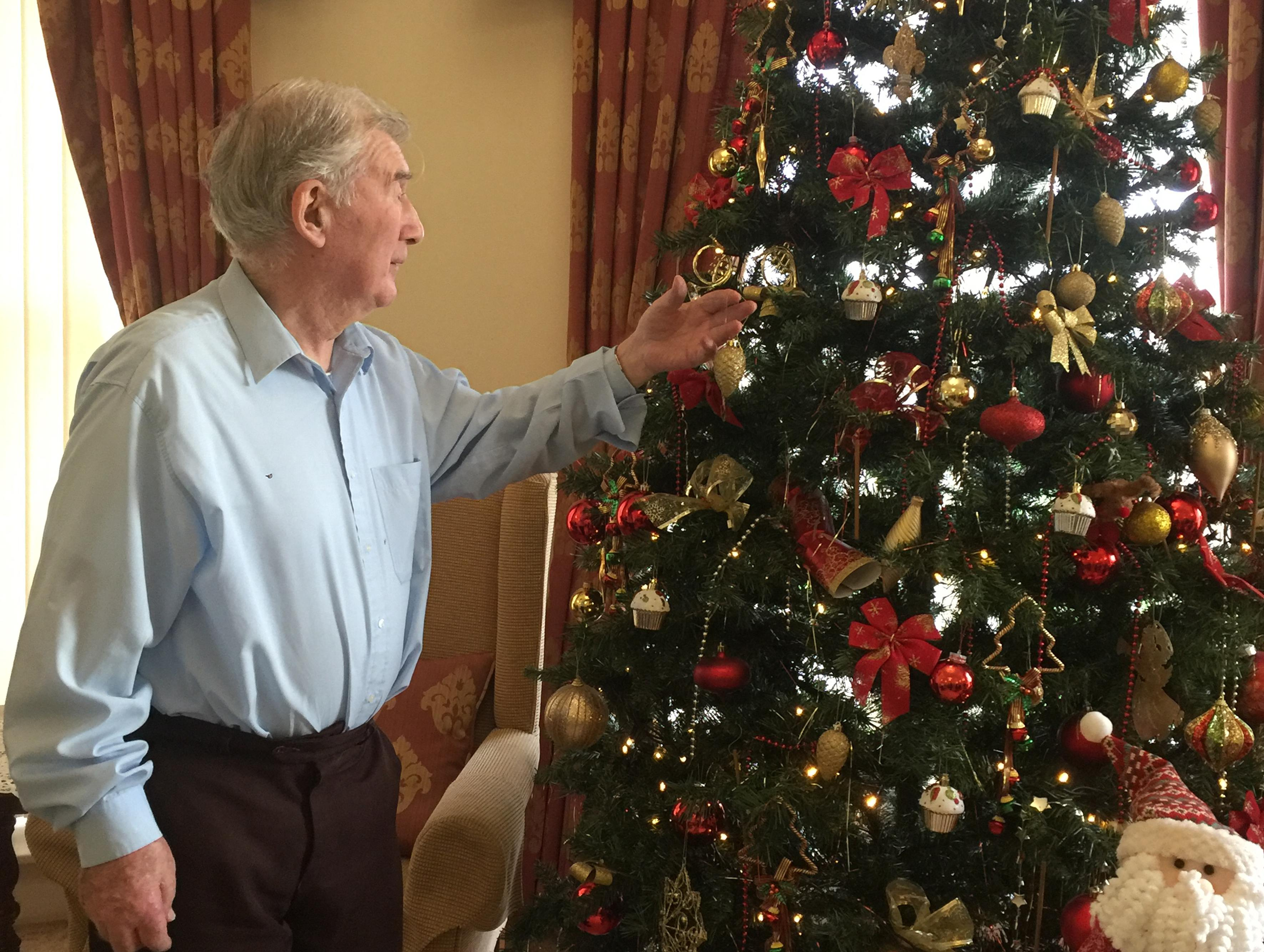 A Blackbrook House resident admires the Christmas tree