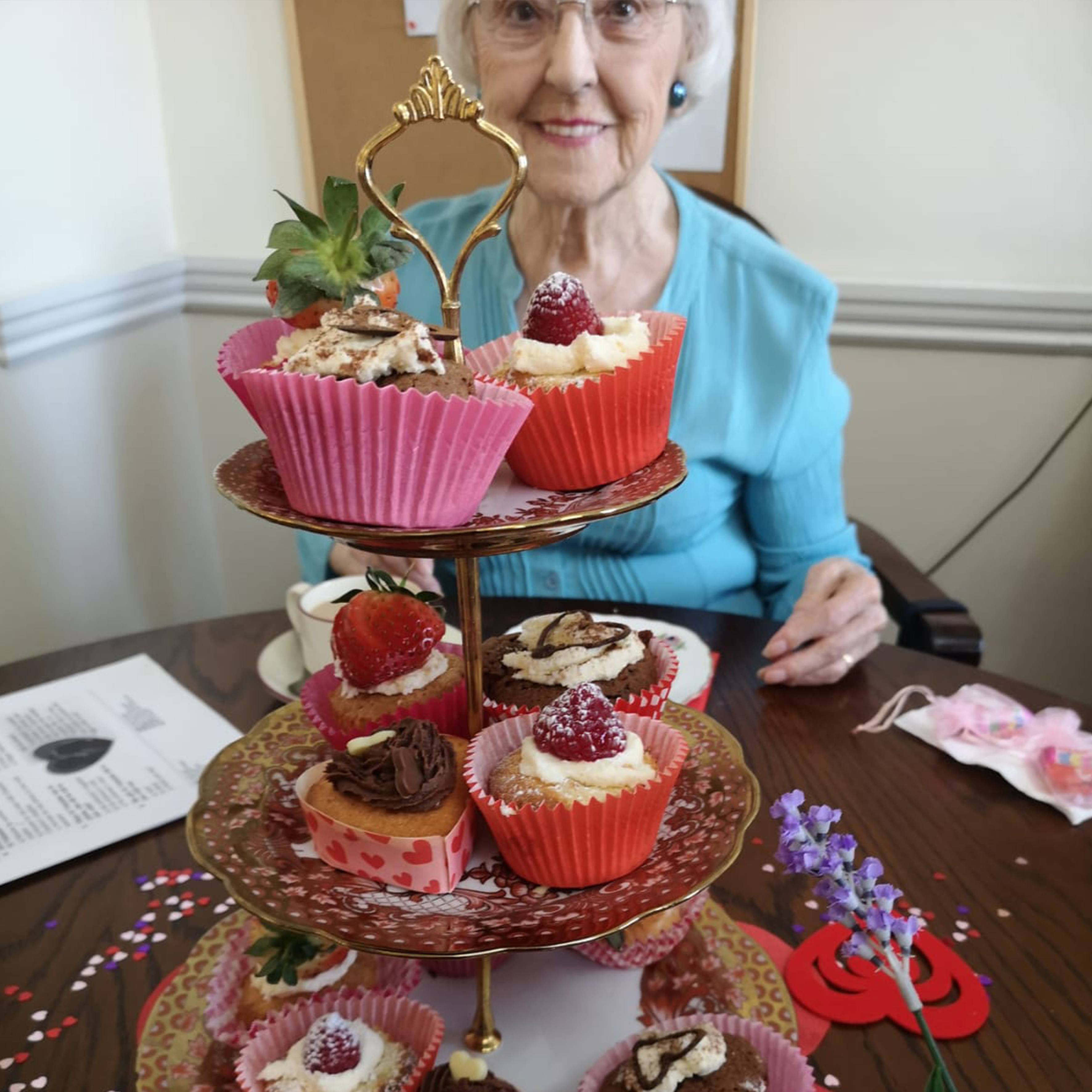Amy with a choice of Valentine's Day cakes