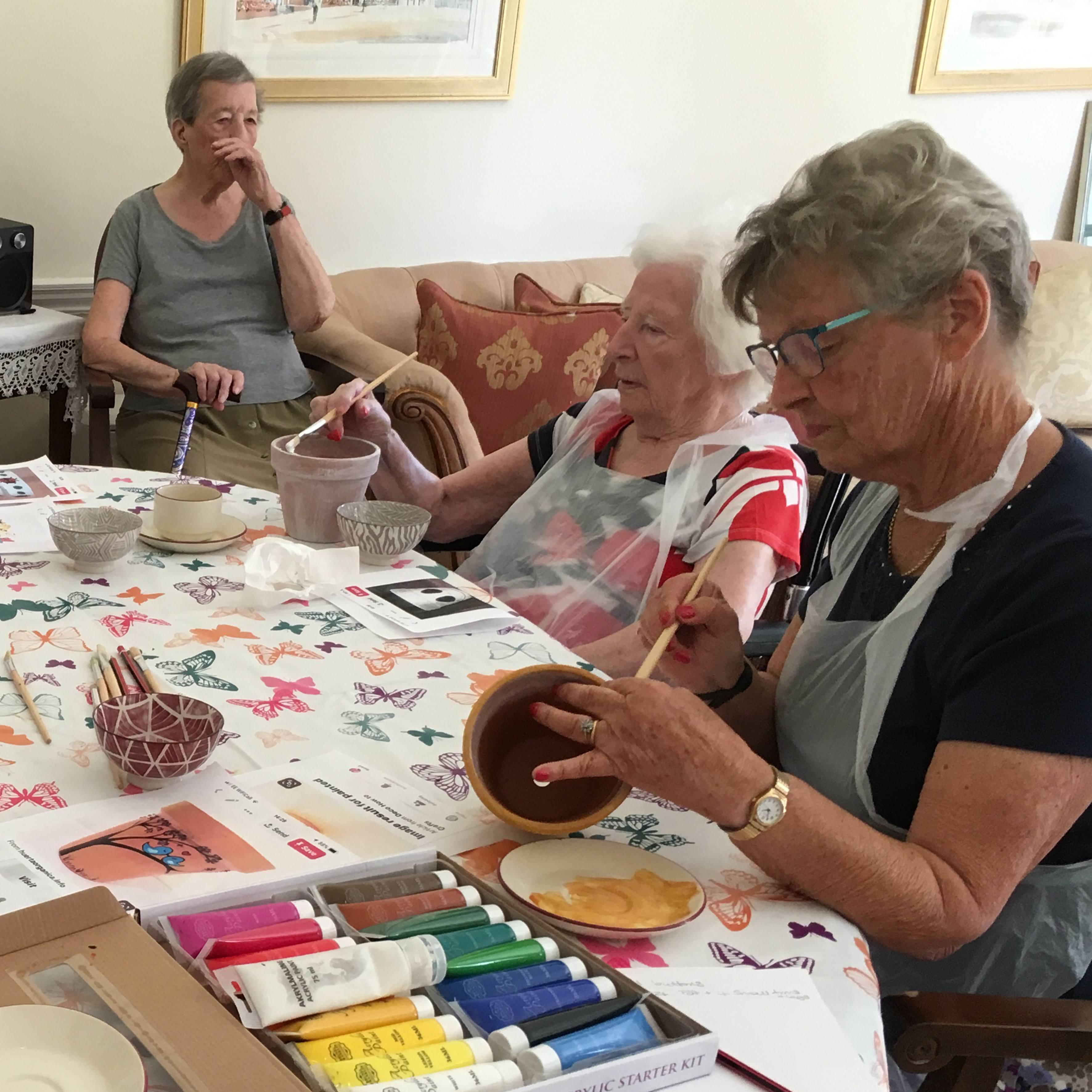 Painting pots at Blackbrook House