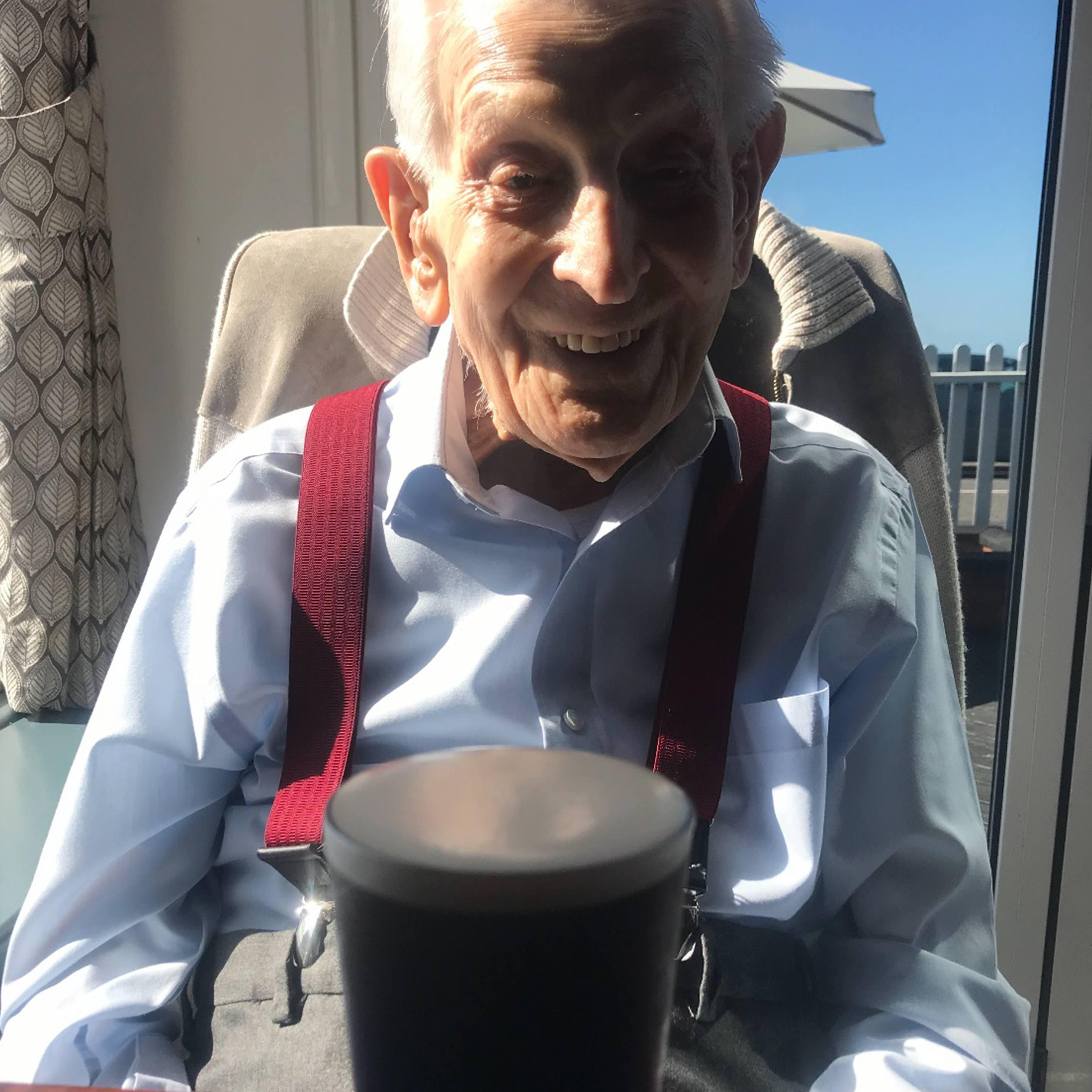 Centenarian Arthur enjoys a pint of beer