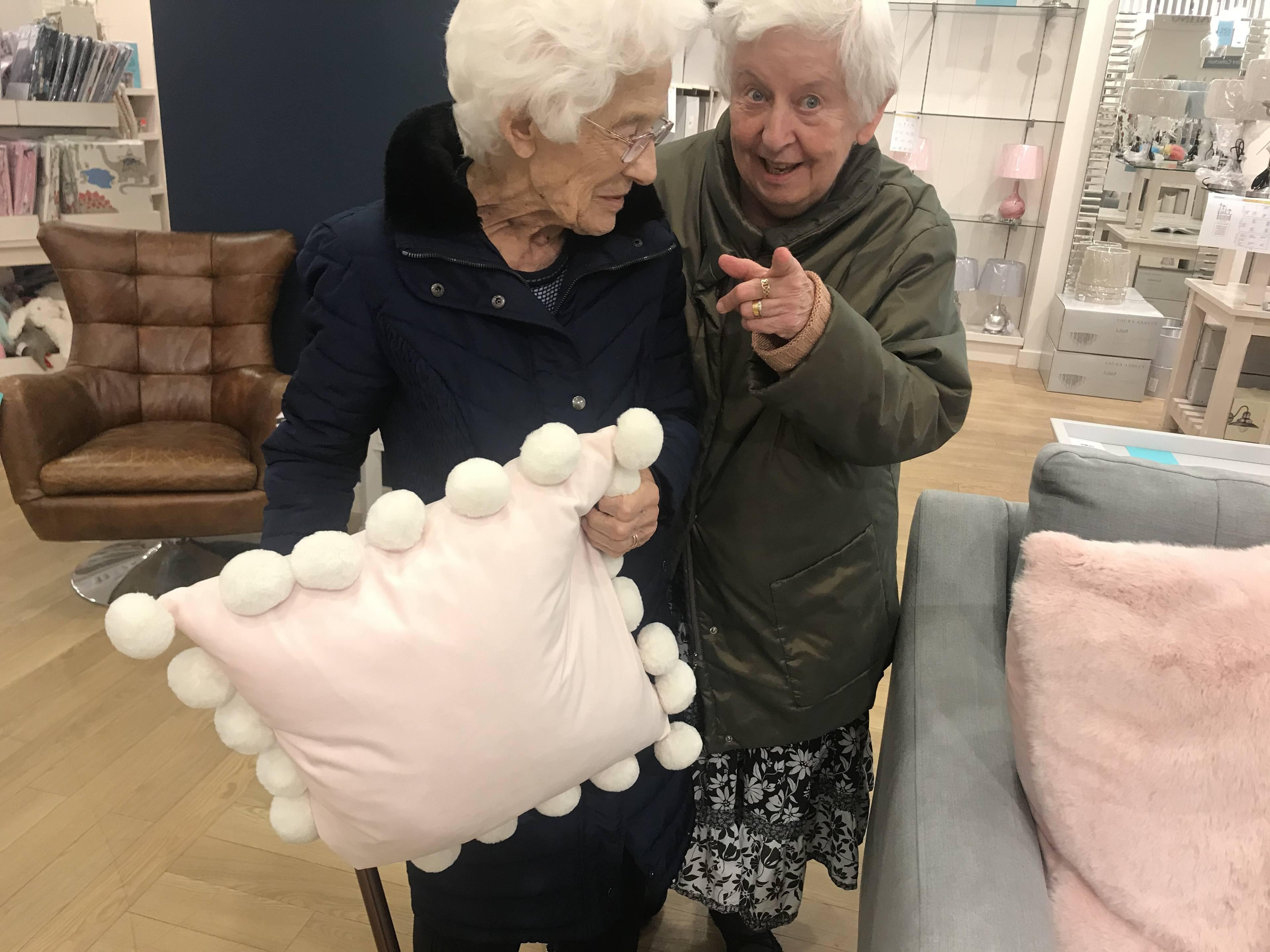 Winn and Cheryl shopping for cushions