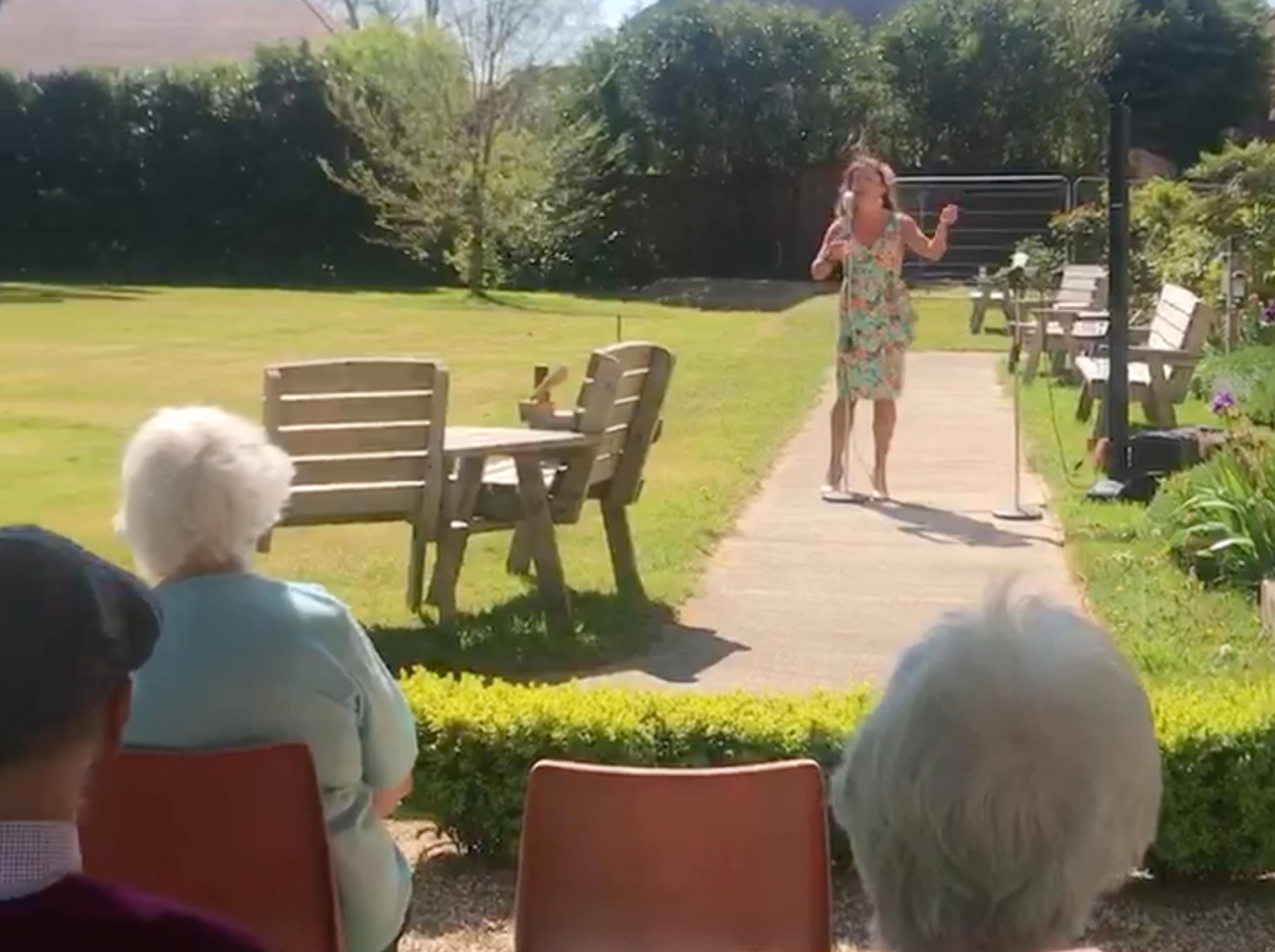 Singer Amy Baker entertains the residents of Blackbrook House