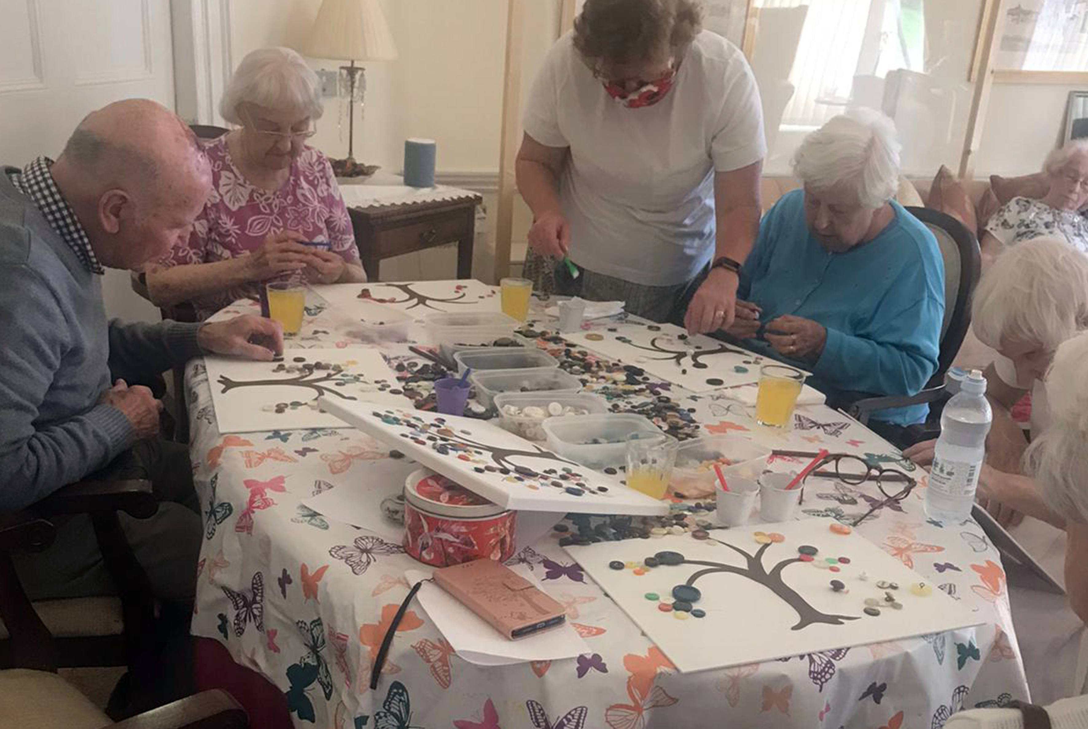 The residents of Blackbrook House enjoying arts and crafts