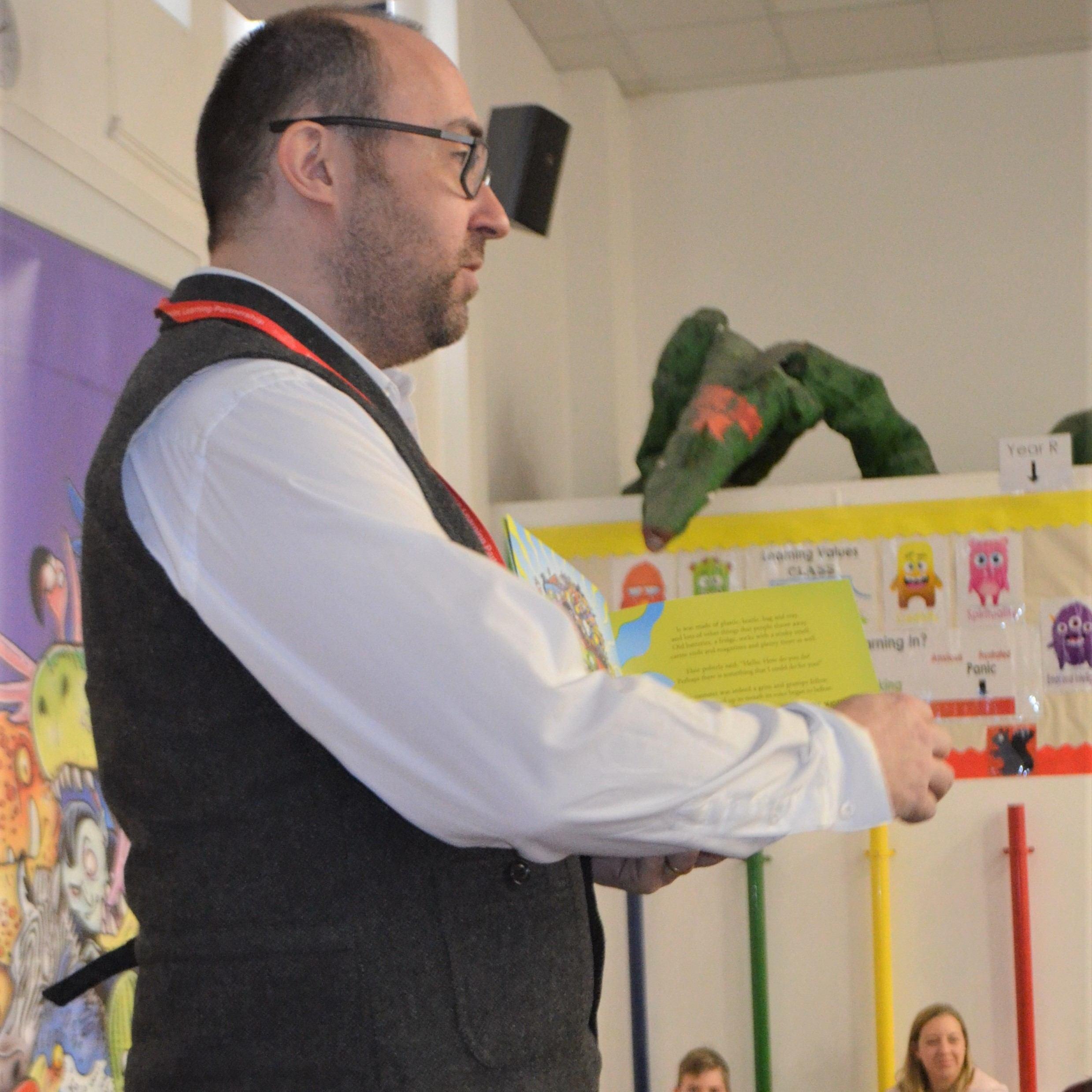 Simon reading to children at Blackfield Primary School