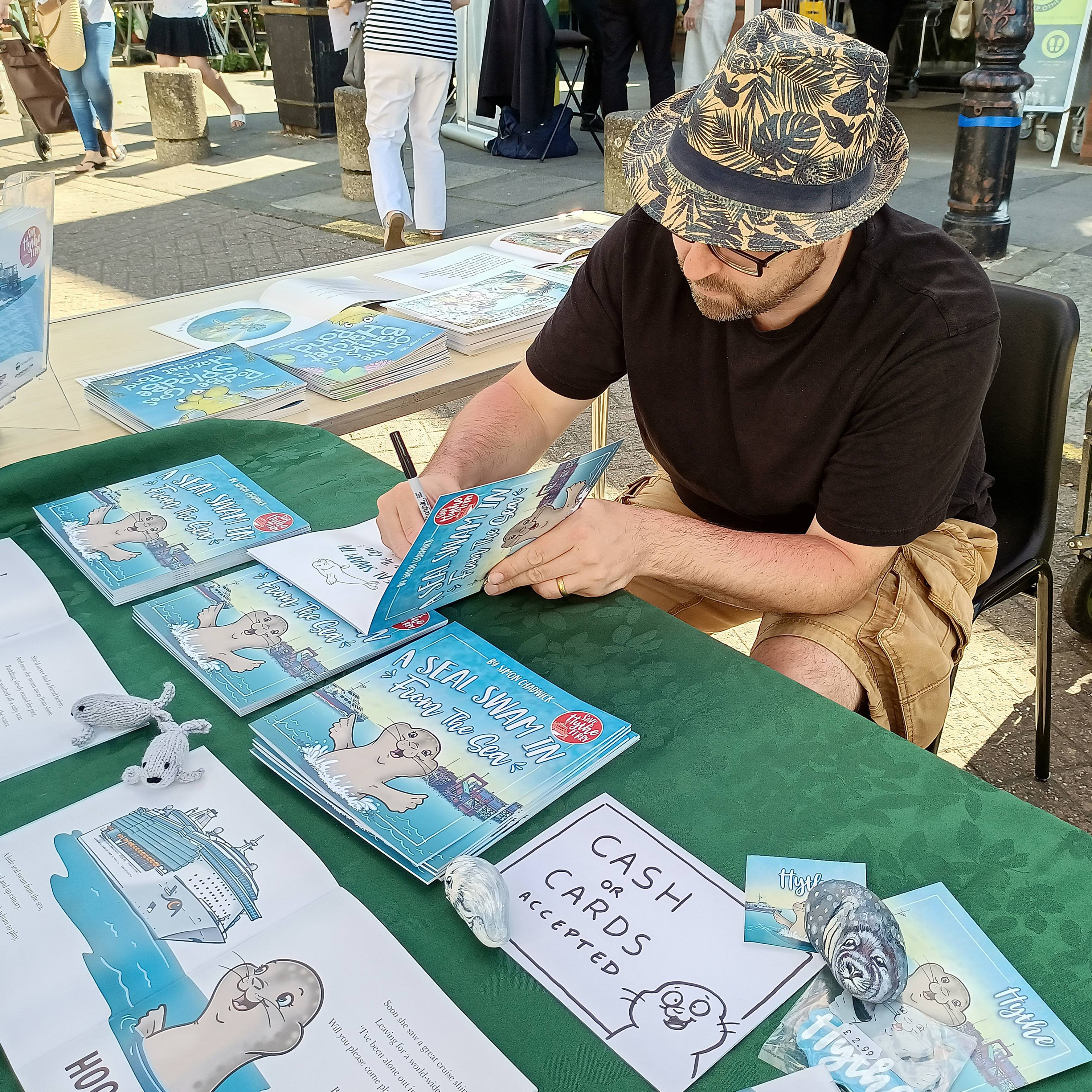 Simon Chadwick signing books in Hythe