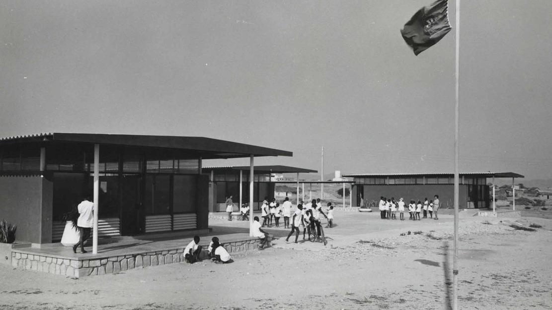 Building and flag raised on flag pole