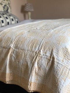 Saffron yellow bedspread