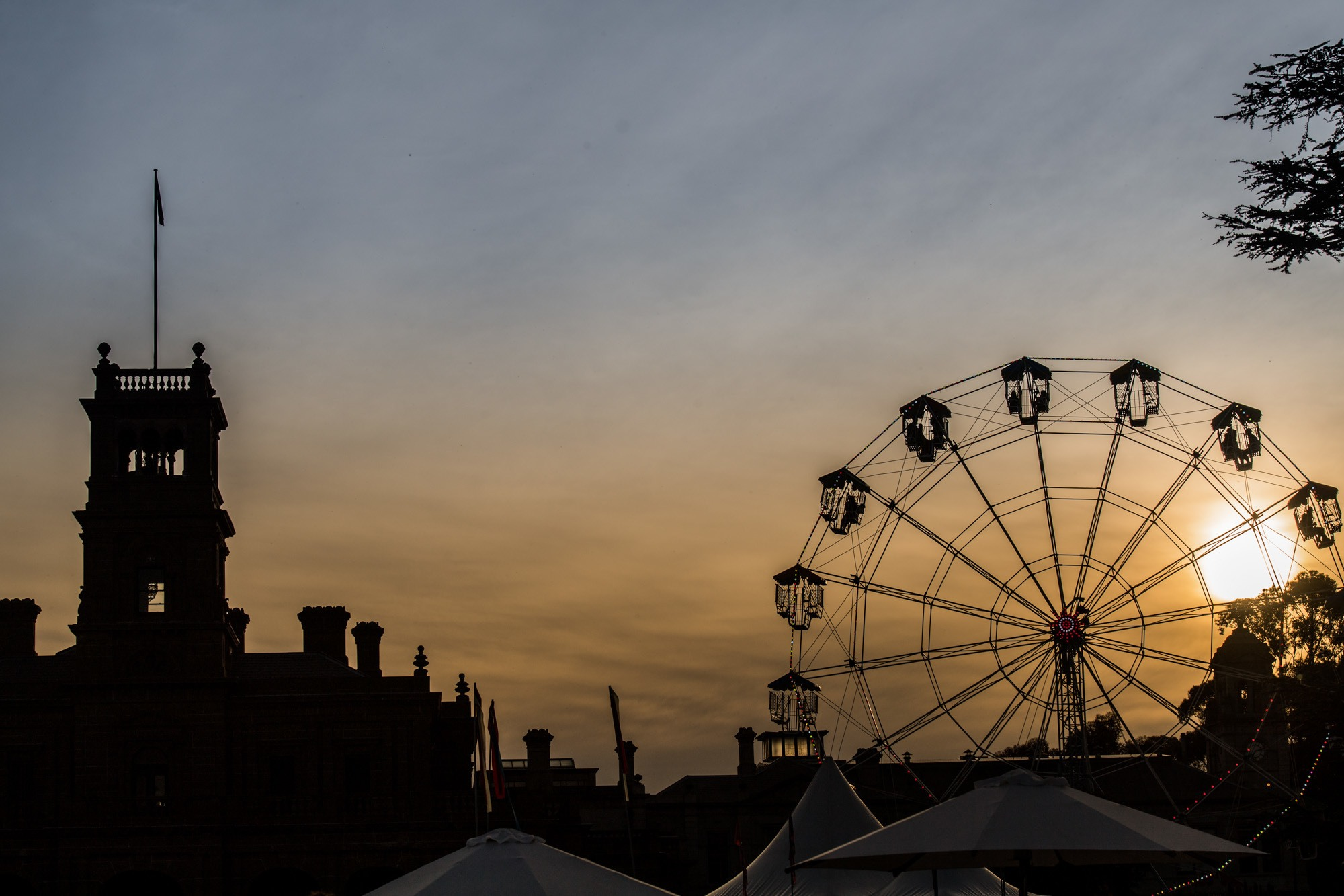 The Werribee Mansion and ferris wheel at sunset