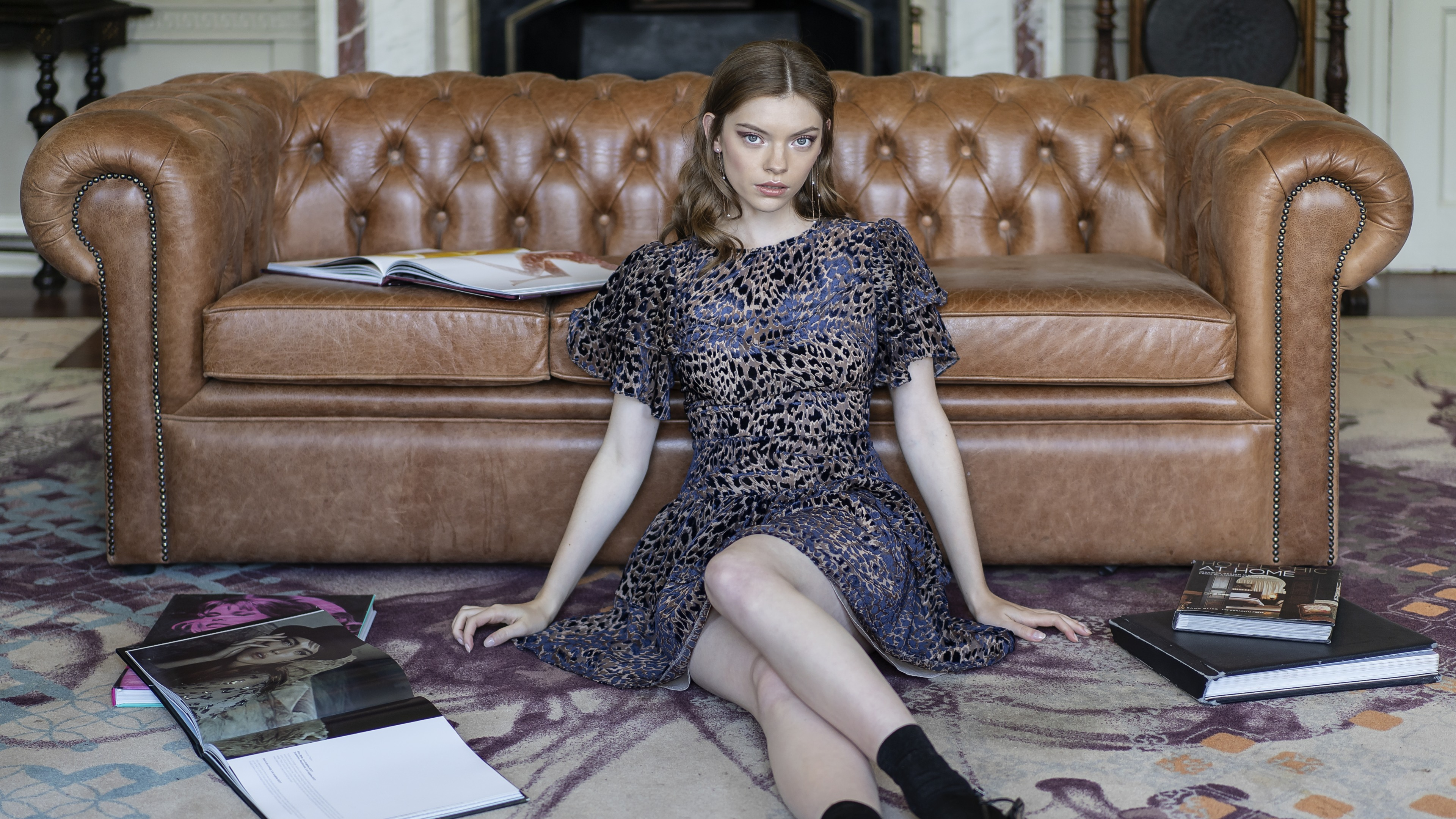 Young woman by sofa