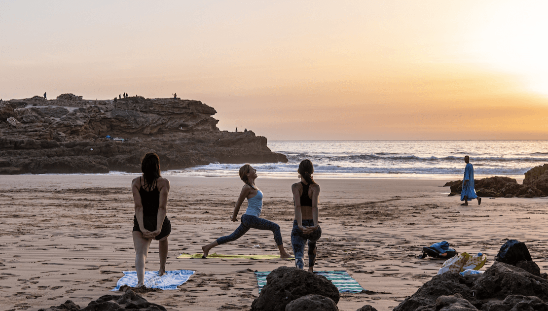 yoga on beach morocco