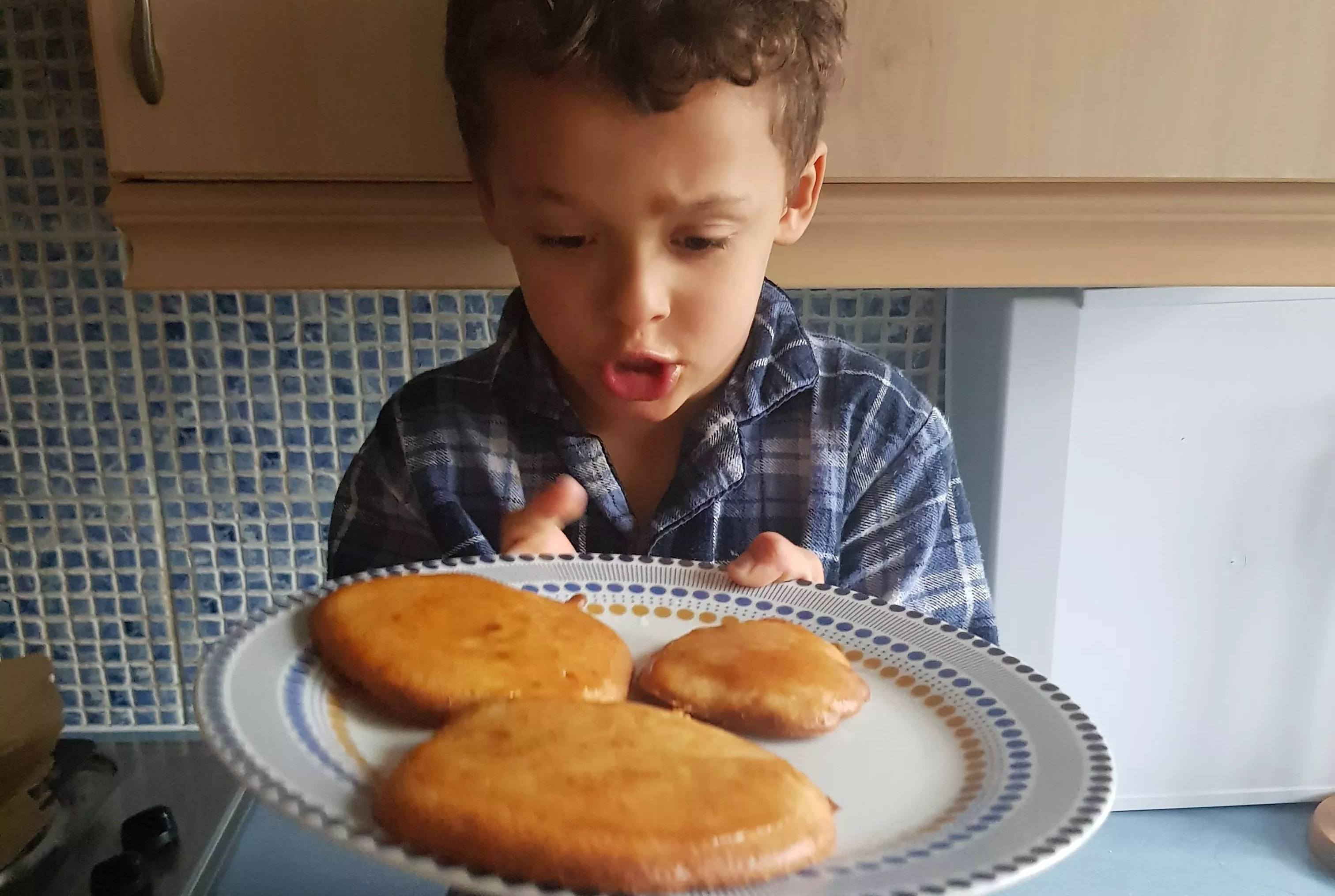 Little boy baking cakes