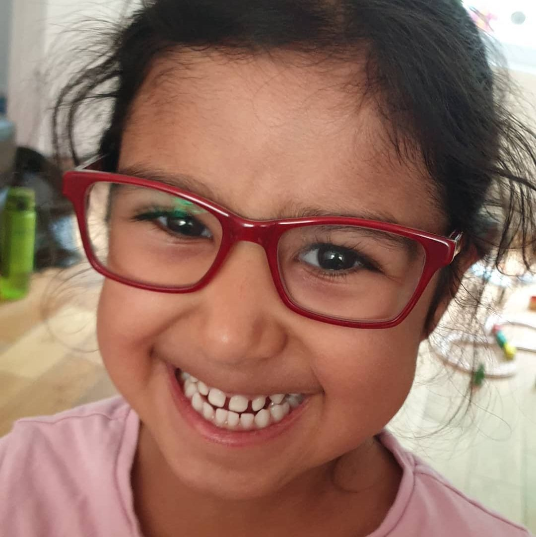Aarvi-red glasses.jpg